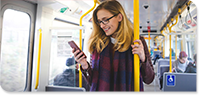 woman on bus looking at phone